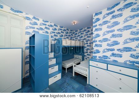 Modern blue childrens bedroom with bunk beds.