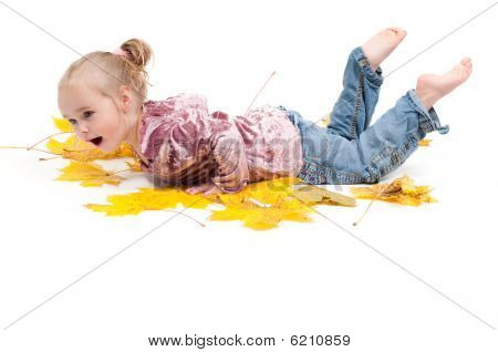 Toddler With Maple Leaves