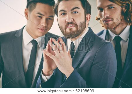 Bearded businessman with evil expression