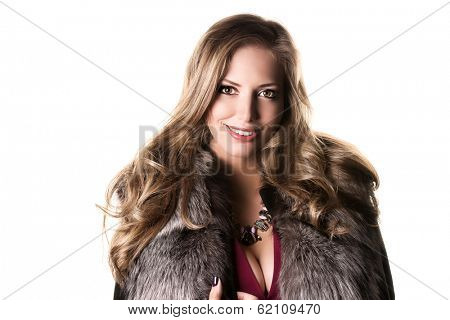 Portrait of a beautiful woman in a fur coat. Isolated over white.
