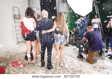 RUSSIA, MOSCOW - DEC 22, 2013: Shooting video clip of the musical group Hello with many feathers in Double Mint Studio.