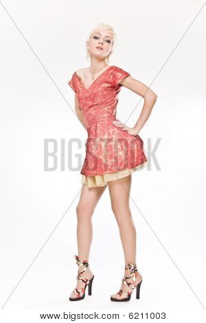 Beautiful Blond Woman Standing In Red Short Dress