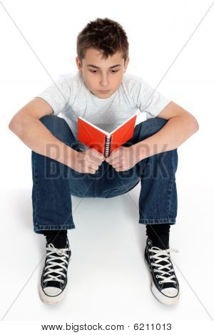Boy Sitting Reading Notebook