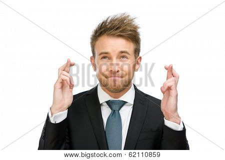 Half-length portrait of businessman with fingers crossed, isolated on white