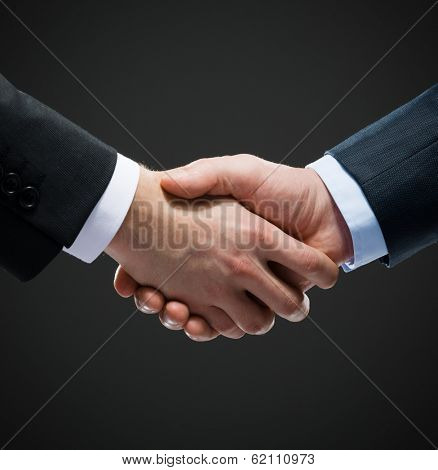 Close up shot of hand shake of business people. Concept of trustworthy relations and business cooperation