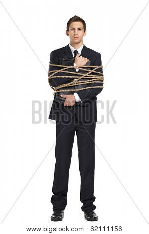 Full-length portrait of businessman handing briefcase who tied with the string, isolated on white. Concept of slavery and violence
