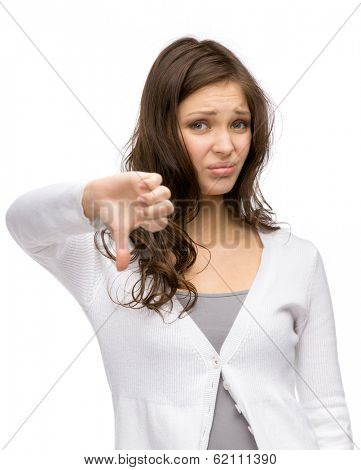 Half-length portrait of lady thumbing down, isolated on white