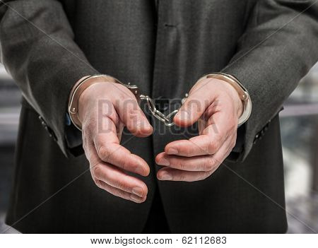 Detail of manacles on criminal's hands