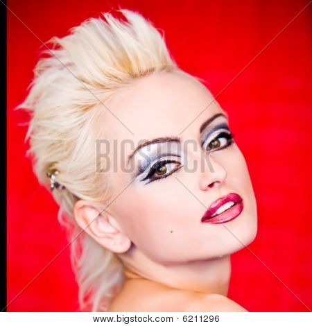 Portrait Of Blond Woman With Pank Hairstyle
