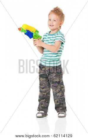 Happy boy with plastic water gun, isolated on white background