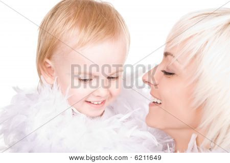 Gentle Child With Her Smiling Mother