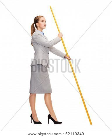business and advertisement concept - calm woman holding flagpole with imaginary flag