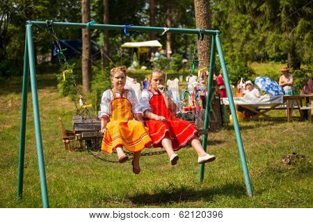 TERVENICHI, RUSSIA - JUL 7, 2013: Unidentified girls during Ivan Kupala Day. The celebration relates to the summer solstice and includes a number of fascinating Pagan rituals