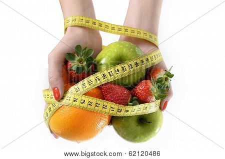 Woman Hands With Fruit  Bond With Measuring Tape Slave To Diet