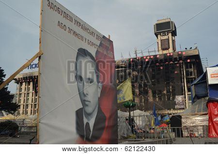 KIEV, UKRAINE - Mar 24, 2014: Stephan Bandera poster (Ukrainian nationalist icon ) near Burnt down the House of trade unions.Riot in Kiev and Western Ukraine.March 24, 2014 Kiev, Ukraine