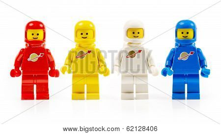 Various astronaut lego mini figures isolated on white.