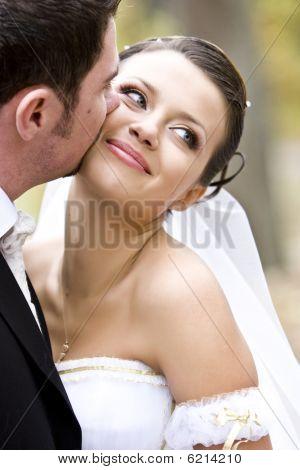 Groom Kissing Charming Smiling Bride