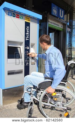 Wheelchair User On A Ticket Machine