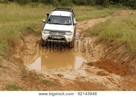 White Toyota Triton Dhd Crossing Mud Obstacle