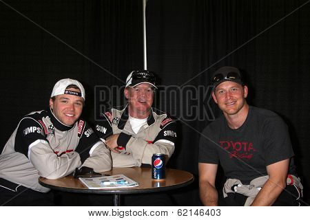 LOS ANGELES - MAR 15:  Brett Davern, Al Unser Jr, Cole Hauser at the Toyota Grand Prix of LB Pro-Celebrity Race Training at Willow Springs Speedway on March 15, 2014 in Rosamond, CA
