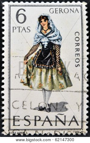 A stamp printed in Spain dedicated to Provincial Costumes shows a woman from Gerona
