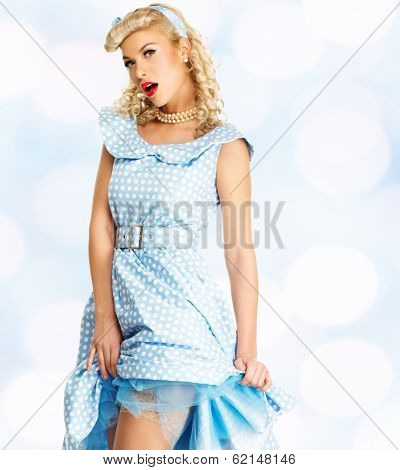 Sexy coquette blond pin up style young woman in blue dress