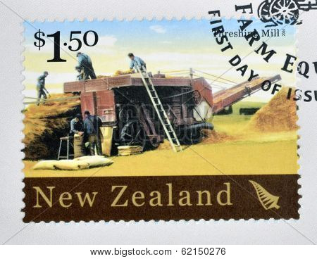 stamp printed in New Zealand dedicated to historic farm equipment shows Threshing Mill