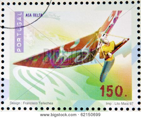 A stamp printed in Portugal dedicated to extreme sports shows Hang gliding