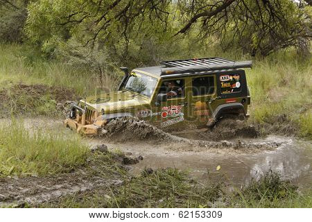 Gecko Pearl Green Jeep Wrangler Rubicon Crossing Muddy Pond