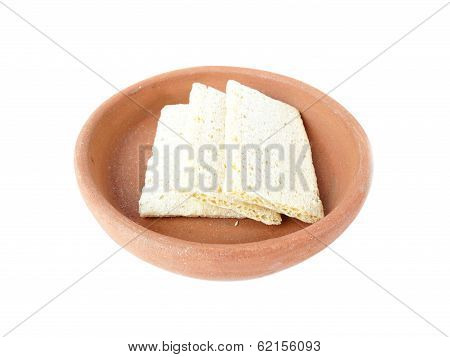 Crispbread from corn grits in bowl of clay isolated on white background