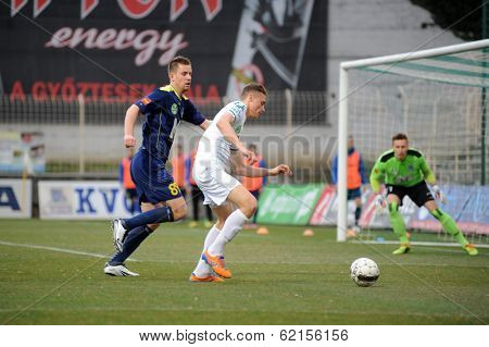 KAPOSVAR, HUNGARY - MARCH 16: Unidentified players in action at a Hungarian Championship soccer game - Kaposvar (white) vs Puskas Akademia (blue) on March 16, 2014 in Kaposvar, Hungary.