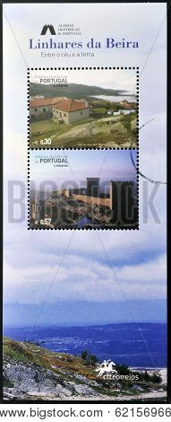stamp dedicated to the historic village of Portugal shows Linhares da Beira between heaven and earth