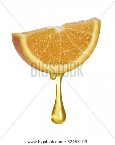 Orange drop down from an orange slice.Pouring orange juice.