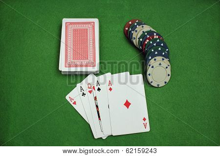 Poker Chips And Cards On The Baize
