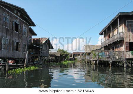 Stilt Houses On River In Thailand