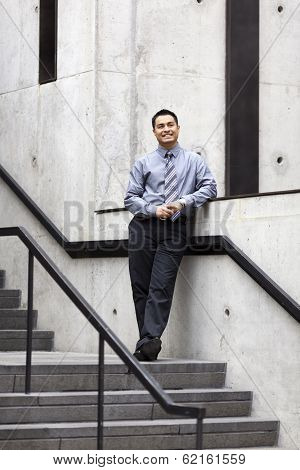 Hispanic Businessman - Leaning On Stair Rail