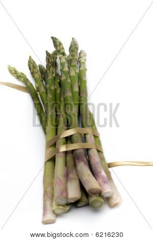Asparagus with gold ribbon isolated on white