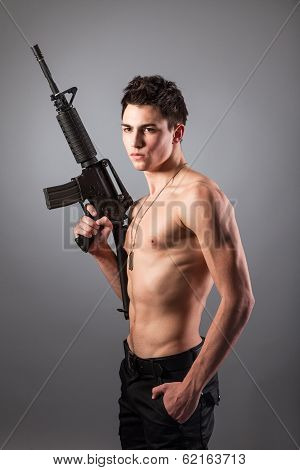 Handsome Bare-chested Soldier Is Holding A Rifle