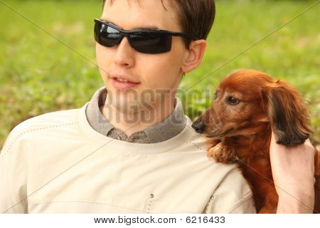 Blind Young Man With Dog-guide