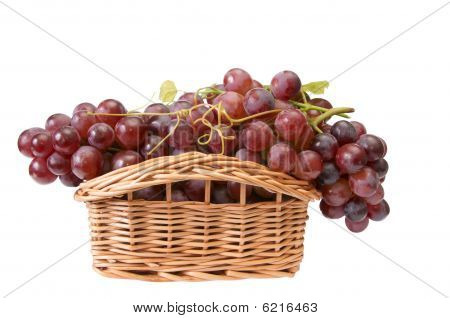 Beautiful Wooden Basket And Ripe Grapes On A White.