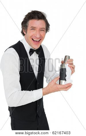 Portrait of happy bartender using cocktail shaker against white background