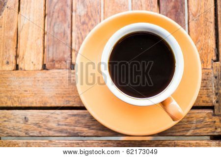 A Cup Of Hot Coffee On Wooden Table