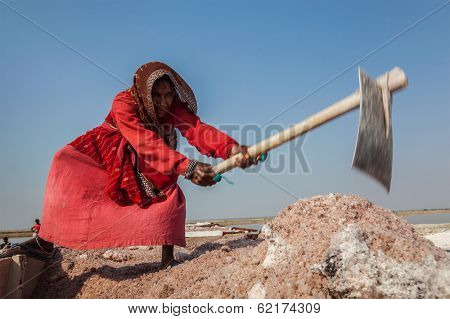 SAMBHAR, INDIA - NOVEMBER 19, 2012: Women mining salt at lake Sambhar, Rajasthan, India. Sambhar Salt Lake is India's largest inland salt lake