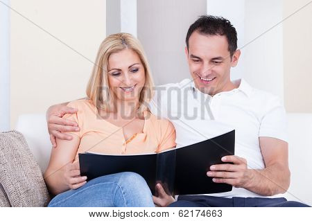 Couple Looking At Album