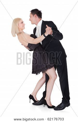 Couple In Formal Attire Dancing