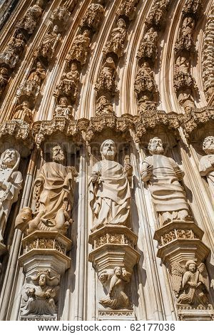 Batalha Monastery. Apostles statues by the left of the Gothic Portal. Masterpiece of the Gothic and Manueline. Portugal. UNESCO World Heritage Site.