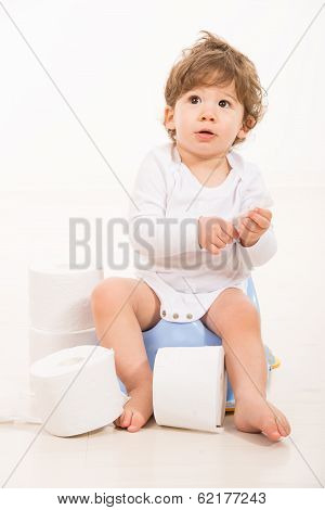 Amazed Toddler Boy On Potty