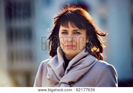 Beautiful Stylish Woman Backlit By The Sun