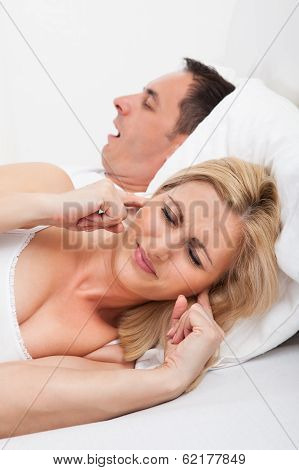 Woman Looking At Snoring Man