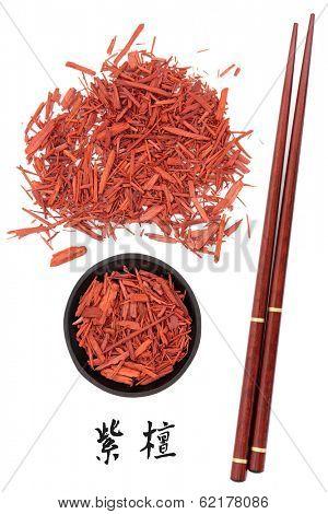 Sandalwood chinese herbal medicine and chopsticks with mandarin script title translation. Tan xiang. Santalum album.